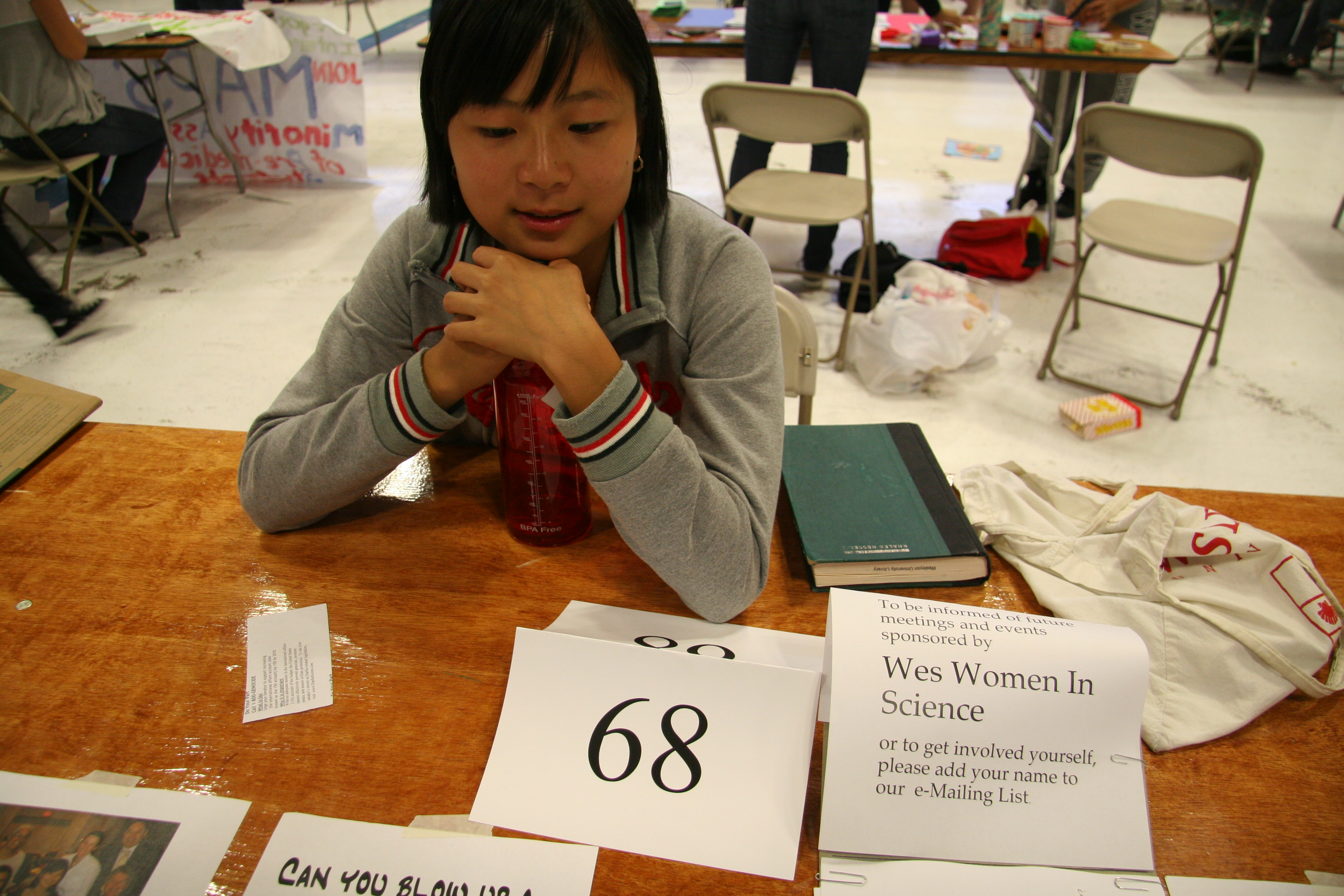 Shuk Kei Cheng '09 encourages Wesleyan students to join Wesleyan's Women in Science club.
