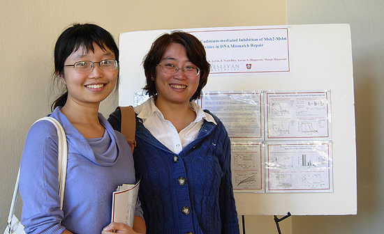 Molecular biology and biochemistry graduate students Yayan Zhou and Jie Zhai present their research at a poster session during the day-long retreat. More than 30 undergraduates, graduate students and post-doc researchers participated in a poster session. Zhou and Zhai work with Manju Hingorani, associate professor of molecular biology and biochemistry.
