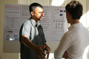 Sattanathan Paramasivan, a graduate student in the chemistry department, talks about his research during a poster session.