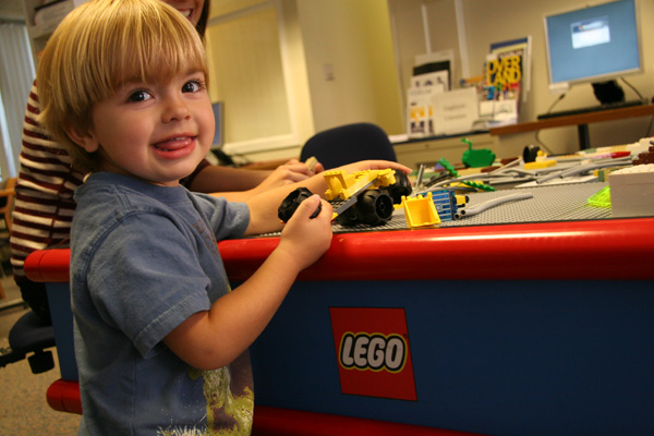 Lucas Rode, 2, plays at the LEGO table. (Photos by Olivia Bartlett and Intisar Abioto '09)