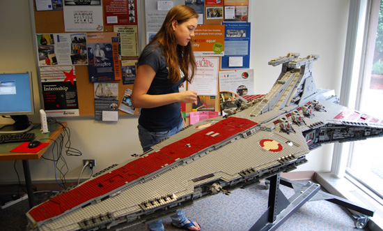 Meredith Rogerson '11 examines the detail on an 8-foot-long Star Destroyer from the Star Wars movies. The starship, built completely of LEGOs, was on display in the Career Resource Center Sept. 15-19.