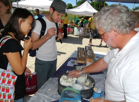 Yulhee Cho '11 and William Schragis '12 sample various goat milk cheeses sold by Beltane Farm in Lebanon, Conn.
