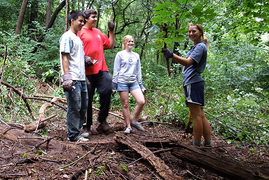 Twenty-one first-year students participated in a Ravine Park community service project Aug. 30 under the guidance of Brian Stewart, associate professor of physics. The students removed several invasive alien species including Japanese barberry, oriental bittersweet and multiflora rose. Pictured above, from left, are Kuan-lin Huang '12, Jonathan Silva '12, Hannah Monk '12 and Katherine Mullins '12.