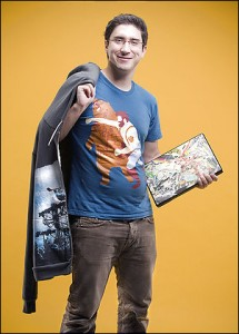 Dan Lachman '09 sports his t-shirt and laptop skin designs. (Photo by Keith Barraclough Photography)