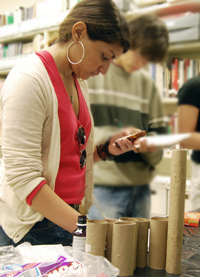 Rebecca Fonticoba '12 takes notes on a plastic container during an Introduction to Archeology lab.