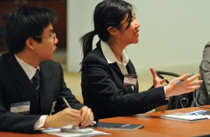 Arion Blas '11 and Kaishi Lee '09 listen to a talk at J.P. Morgan Chase in New York City on Oct. 27 during Wesleyan's Management and Leadership Conference.