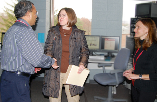 "Ganesan ""Ravi"" Ravishanker, associate vice president for Information Technology Services, introduces himself to Dena Matthews, publication production manager, during the Information Technology Services open house Nov. 12. Matthews was learning about ITS's New Media Lab from Melissa Datre, director of the New Media Lab, pictured at right."