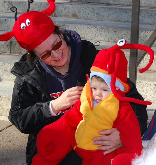 Six-month-old Sam Higgins, dressed as a lobster, celebrates Halloween on the Wesleyan campus with his mother, Sally Ross. Sam is the son of Scott Higgins, associate professor of film studies. More than 50 children children enrolled in the Wesleyan Neighborhood Preschool walked in the annual Halloween Parade Oct. 31 on Wesleyan's campus.