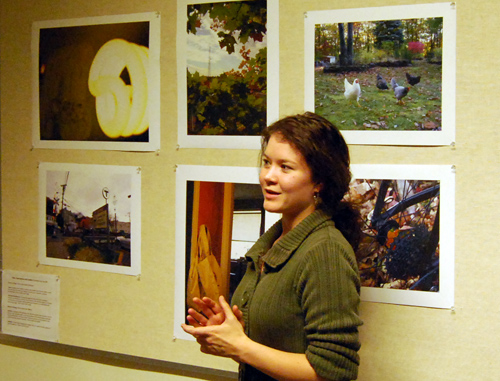 "NAME speaks about her photograph titled ""NAME"" during the opening reception for the exhibit <i>Photographic Window on Causes of Climate Change</i> Nov. 5 in Van Vleck Observatory."
