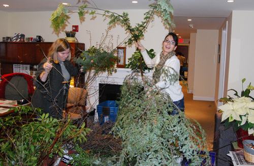 "The Center for Community Partnerships hosted a ""Green Your Holiday"" craft event Dec. 6 for the Wesleyan staff, faculty and students and the local community. Volunteer Shelia Gray Smith, at left, taught participants how to make festive centerpieces using fresh pine greens."
