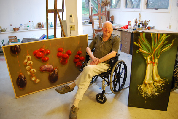John Frazer, professor of art, emeritus, taught drawing and film classes consecutively at Wesleyan from 1959 to 2001. He's pictured here in his Middletown studio with two of his own paintings. (Photo by Olivia Bartlett)