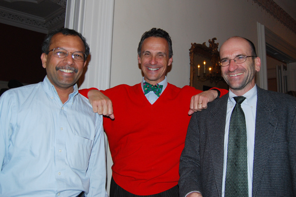 """Michael Roth, center, welcomes Ganesan """"Ravi"""" Ravishanker associate vice president for Information Technology Services and Steve Machuga, director of administrative systems, to his holiday party."""