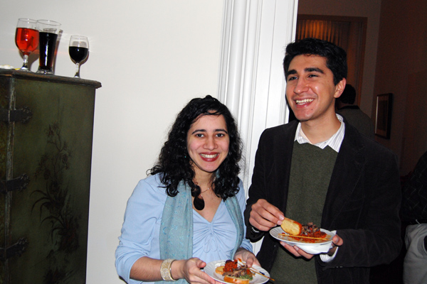 Roxanne and Tushar Irani, assistant professor of letters, assistant professor of philosophy, enjoy hors d'oeuvres, which were served at the party.