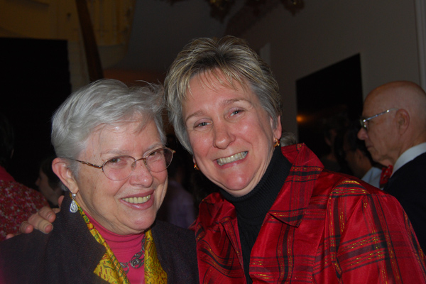 Joan Miller, wife of Richard Miller, the Woodhouse/Sysco Professor of Economics, emeritus, mingles with Meg Zocco, director of parent programs and development. Dick Miller is pictured in the background.