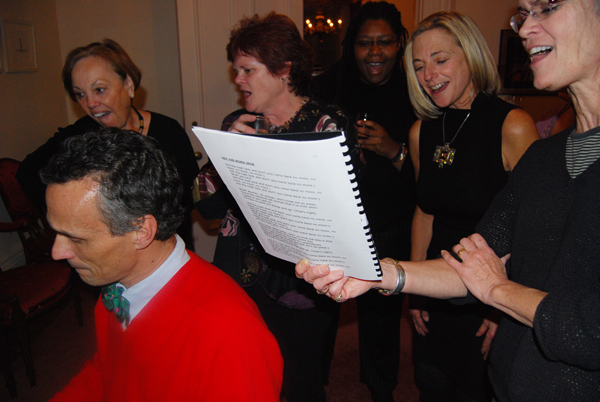 Wesleyan President Michael Roth plays piano while Gina Driscoll, associate director of development events; Nancy Meislahn, dean of admission and financial aid; Roth's wife Kari Weil, visiting professor of letters and faculty fellow; and Louise Brown, dean for academic advancement/dean for the Class of 2009, sing along. President Roth held a holiday party at his home for faculty and staff on Dec. 11.