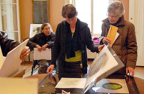 uffin O'Dench, former curator; Claire Rogan, title, and Jean Shaw, title, browse artwork for sale during the Friends of the Davison Art Center Holiday Print Sale Dec. 4.