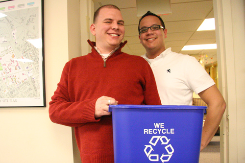 Jonathan Curry, TITLE, and Alex Cabal, area coordinator, have replaced their plastic trash cans with recyclable containers in Residential Life.