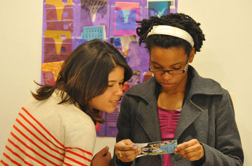 At left, Priya Ghosh '09, one of the student curators who started the show three years ago, and Karimah Nichols '09 look over art together.