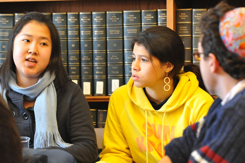 At left, Jenny Lo '10 talks about how her semester studying abroad altered her view on the Gaza war, while Melina Aguilar '10 looks on.