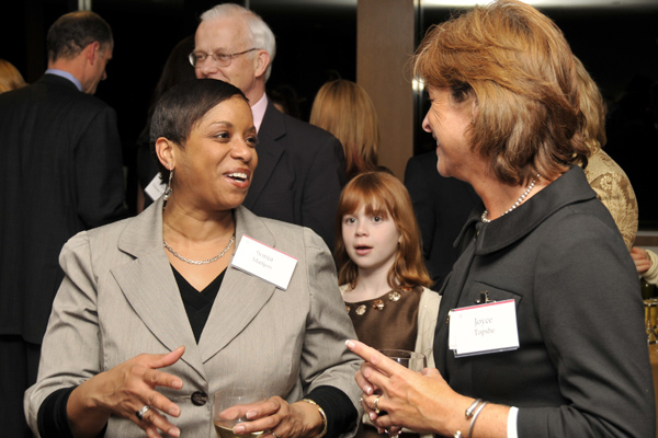Sonia Mañjon, vice president for diversity and strategic partnerships, speaks with Joyce Topshe, associate vice presiddent for facilities, during the Daniel Family Commons dedication. Pictured in back, center, is India Daniel.