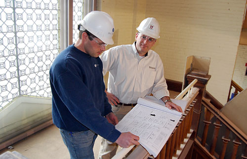 At left, Scott Martin, superintendent of PAC Group LLC in North Haven, Conn. discusses floor plans with Alan Rubacha, construction services consultant, inside the former Davenport Campus Center on March 16.The building is undergoing an interior remodeling project and will re-open as The Allbritton Center for the Study of Public Life for the Fall 2009 semester.