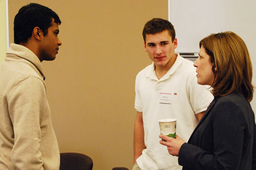 Anand Satchidanandan '08, assistant director of the Wesleyan Fund, and Jeff XX speak with Jody Hill '78 during the third Student Leadership Lunch Feb. 28 in Usdan University Center. The lunches are hosted by the Alumni Association to recognize student leaders and to provide them with an opportunity to meet and learn from prominent alumni leaders.