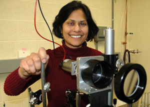 Ishita Mukerji, professor of molecular biology and biochemistry, uses a UV resonance Raman spectrometer to measure molecular vibrations. She examines the structure of DNA, to understand how protein modulation of the structure can lead to tumors and other diseases.
