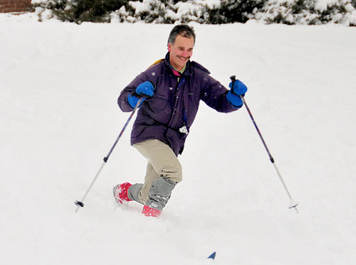 Stephen Devoto, associate professor of biology, associate professor of neuroscience and behavior, skis down Foss Hill.