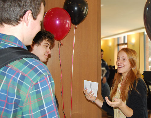 At right, Katherine Eyster '10, speaks to students about the tuition transition. Wesleyan's tuition, room and board costs about $69,000 a year. Students pay $49,000, and a tuition grant from alumni and parents through the Wesleyan Fund, along with the endowment, picks up the additional $20,000 per student.