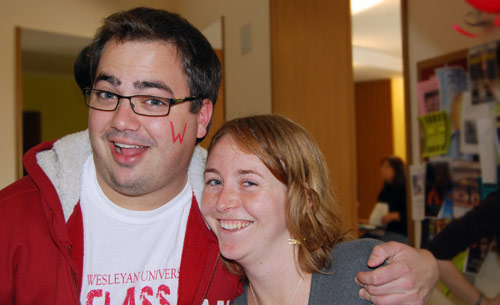 """Ruby Ross '09 volunteered to paint a red """"W"""" on students' cheeks during the event. At left is Erik Underwood '09."""