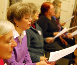 Linda Secord, a member of the Greater Middletown Chorale, practices Schubert's <em>Mass in G</em> in preparation for a concert April 19 at Crowell Concert Hall.