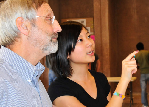 Shuk Kei Cheng '09 talks to David Bodznick, dean of Natural Sciences and Mathematics, professor of biology, professor of neuroscience and behavior, about her project titled &quot;Anodic Oxidative Functionalization of Tolune Derivatives.&quot;