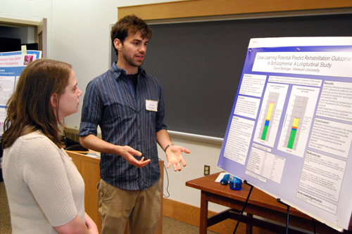 "David Baranger '09 talks about his research titled ""Does Learning Potential Predict Rehabilitation Outcome in Schizophrenia"" to Barbara Juhasz, assistant professor of psychology."