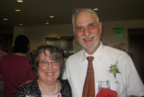 Wolfe earned a bachelor of arts degree from Rutgers University, a master of arts ad eundem gradum from Wesleyan and a Ph.D from the University of California, Berkeley. He's taught cell biology, human biology, biology of aging and the elderly and structural biology. Wolfe is pictured above with Linda Strausbaugh Ph.D. '77.
