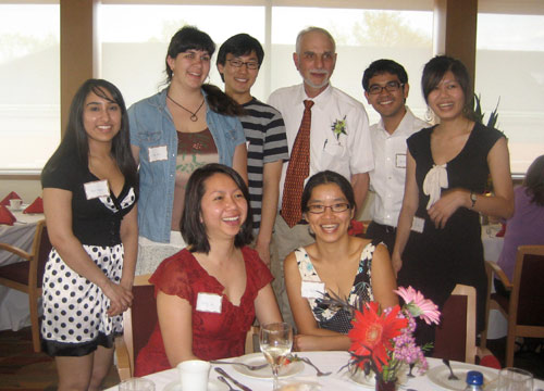 About 80 colleagues, friends and family gathered in the Daniel Family Commons April 26 to honor Jason Wolfe, professor of biology, emeritus, for his retirement from Wesleyan. Wolfe taught biology at Wesleyan for 39 years. Pictured are former and current members of the Wolfe Lab. Front row, from left, are Emily Lu '00 and Vey Hadinoto '99.  Back row, from left, are Aditi Khatri '11, Joan Bosco '09, Hyo Yang '12, Professor Wolfe, Carlo Balane '06 and Ivy Chen '09.