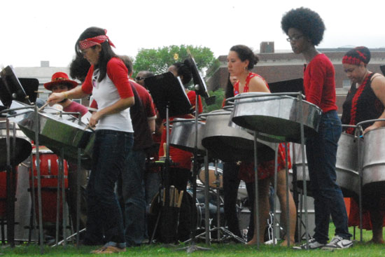 Student performers are taking the class MUSC 450, taught by William Carbone, private lessons teacher. In addition to performing on steel band instruments, the students study , historical and cultural context of the ensemble. (Photos by Alexandra Portis '09)