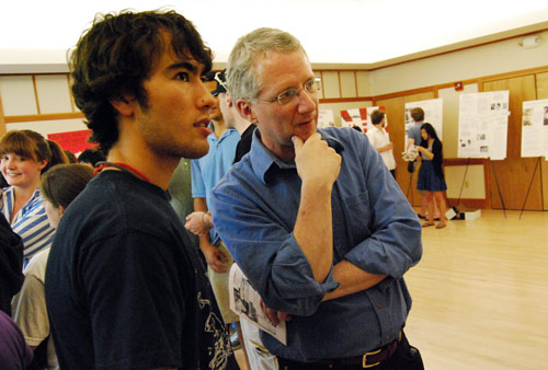 Paul Gerdes '09 explains his research to Bill Johnston, professor of East Asian studies, professor and chair of history, professor of science in society and tutor in the College of Social Studies.