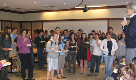 Michael Weir, director of the Hughes Program in the Life Sciences, professor of biology, speaks to students at the 21st Hughes Summer Research Program pizza party May 27.