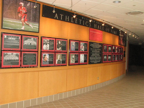 "Entering the next Athletics Hall of Fame wall are Emilio Daddario '39, Winthrop ""Wink"" Davenport '64, Sally Zimmer Knight '81, Kofi Appenteng '81 and the baseball team of 1994."