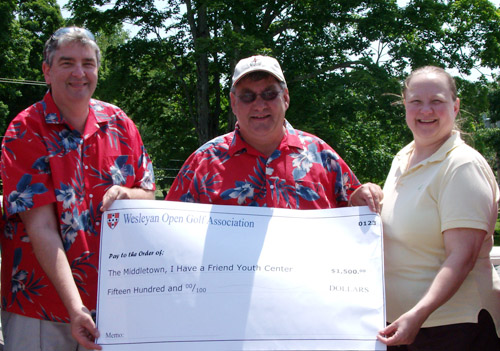 Higgins and Meyer hand over the check to Bartholomew. All participants pay an entry fee which includes an 18-hole round, prizes and dinner. A portion of the fee is collected for a different charity in Middletown.