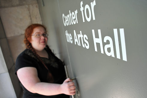 Elizabeth Goldgar '11 enters the new Center for the Arts Hall on Aug. 14. Formerly called the cinema, the CFA Hall is one of several performance and exhibition spaces on the Wesleyan campus.