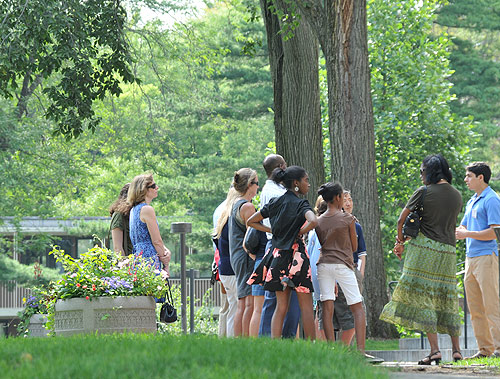 XX, at far right, speaks about Olin Memorial Library to a tour group July 30.