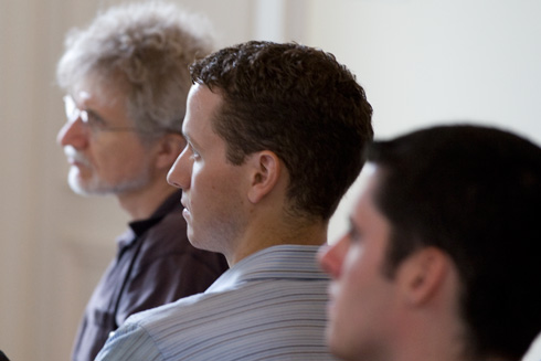 At left, Michael Weir, director of the Hughes Program in the Life Sciences, professor of biology, and in center, Brian Northrop, assistant professor of chemistry, listen to Olson's presentation.