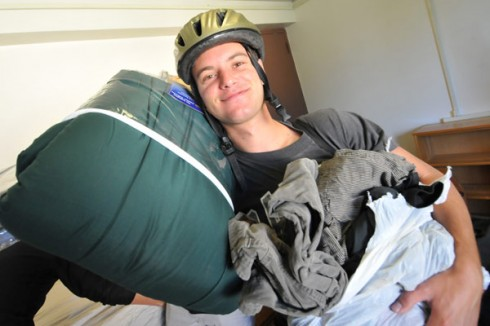 Noah Klein-Markman '13 of Berkley, Calif., unloads his belongings inside his Butterfield Residence Hall room at 8:30 a.m. Sept. 1. His parents, Laura Klein and Henry Markman, and brother, Sam, helped Noah move in.