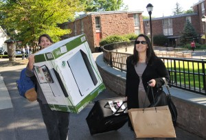 Robert Vance '13 of Burmingham, Ala., and his mother, Joyce White Vance, move Robert's belongings into his Butterfield Residence Hall room. The dorm-size regrigerator was an early birthday present from Robert's grandmother.