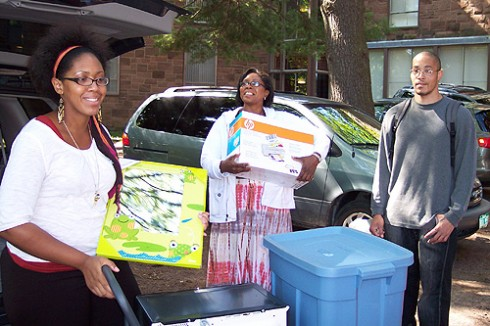 Jacquelynn West '13, left, moves into Butterfield Residences with the help of her family.