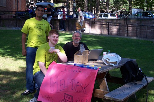 Ryan Gee '11, Sam Lyons, and Jim Degolia P '13 man an ITS Help Desk outside the Butterfield Residence Halls.