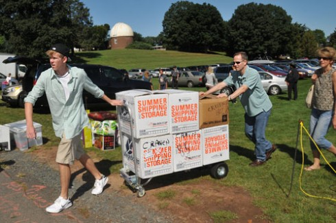 Families parked on Andrus Field and moved items into Clark Hall.