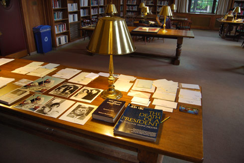 The silent auction included collectible titles and older, scares and unusual items. Pictured here, JFK memorabilia awaits bidding at the silent auction in the Smith Reading Room.