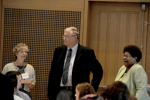 Mike Zebarth, director of PIMMS, speaks to Elizabeth Buttner, State Department of Education K-12 science consultant (left), and Charlene Tate-Nichols, State K-12 mathematics consultant.